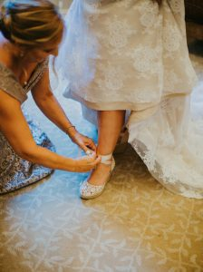 Putting on the shoes with the dress