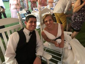 Jesse and AnnaTaylor in rocking chairs at their reception