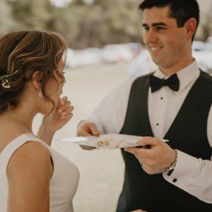 Groom feeding his new bride the cake