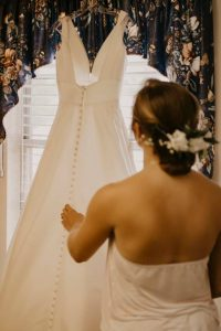 AnnaTaylor looking at her dress