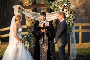 Mack and James with the preacher at the alter