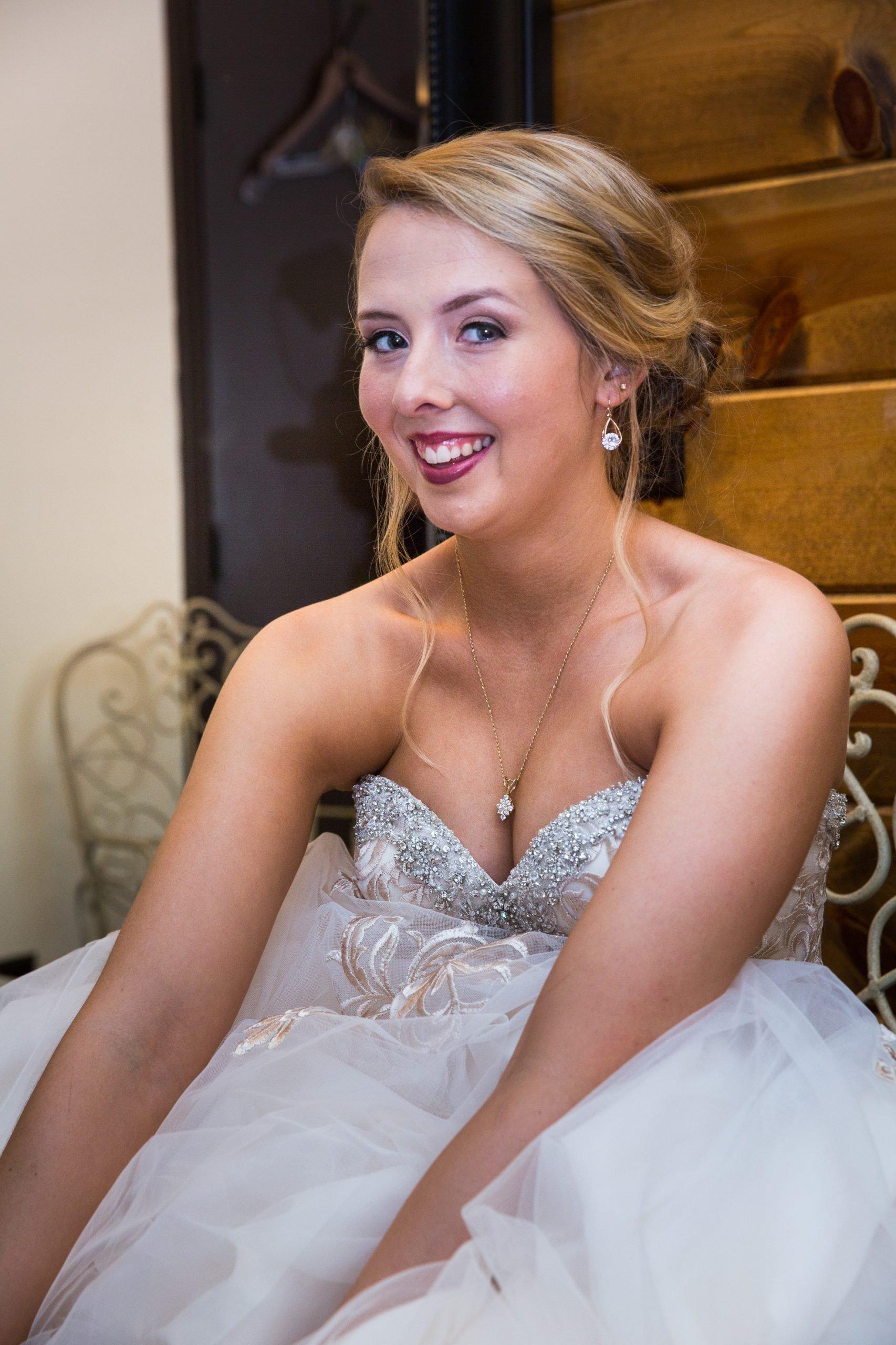 Mackenzie grinning in her dress
