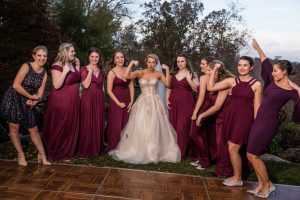 Bride makes muscle pose with her bridal party