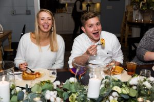 Mack and James eating at the rehearsal dinner