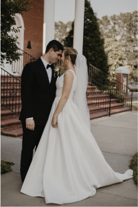 Jesse and AnnaTaylor in front of their church